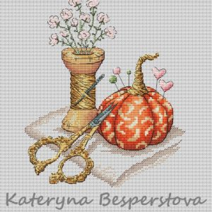 Pumpkin pincushion. Gold scissors