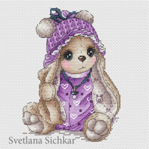Bunny baby in lilac outfit
